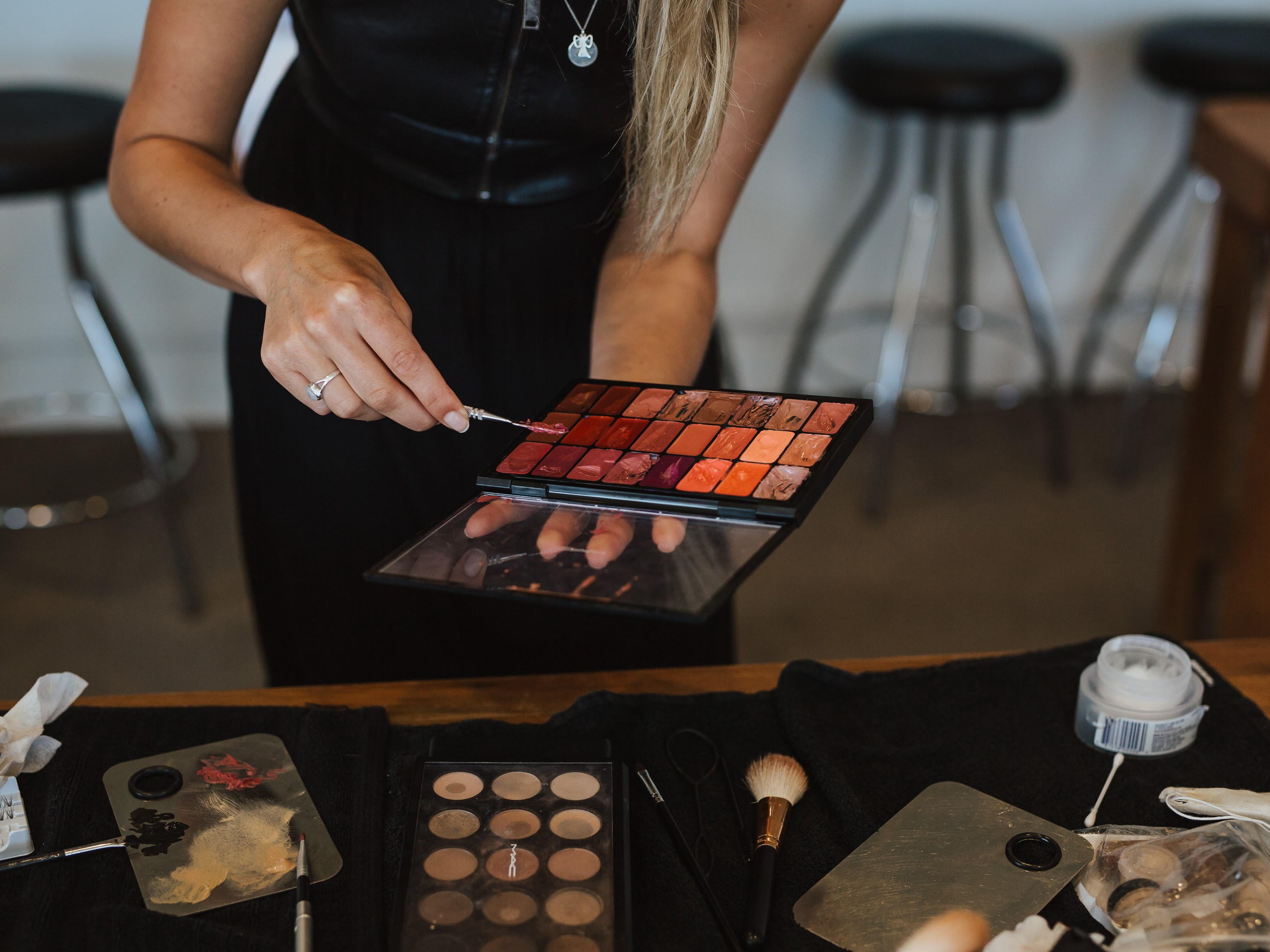 Makeup artist 'Sita Engling' showcasing her professional makeup station set up with makeup brushes, foundation, eyeshadow and lipstick palettes.