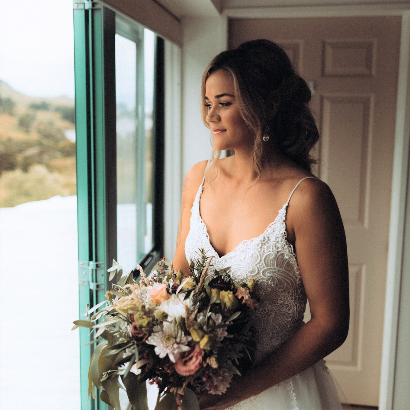 Dewy skin-bronzed and peach toned natural makeup with lashes-rustic style wedding