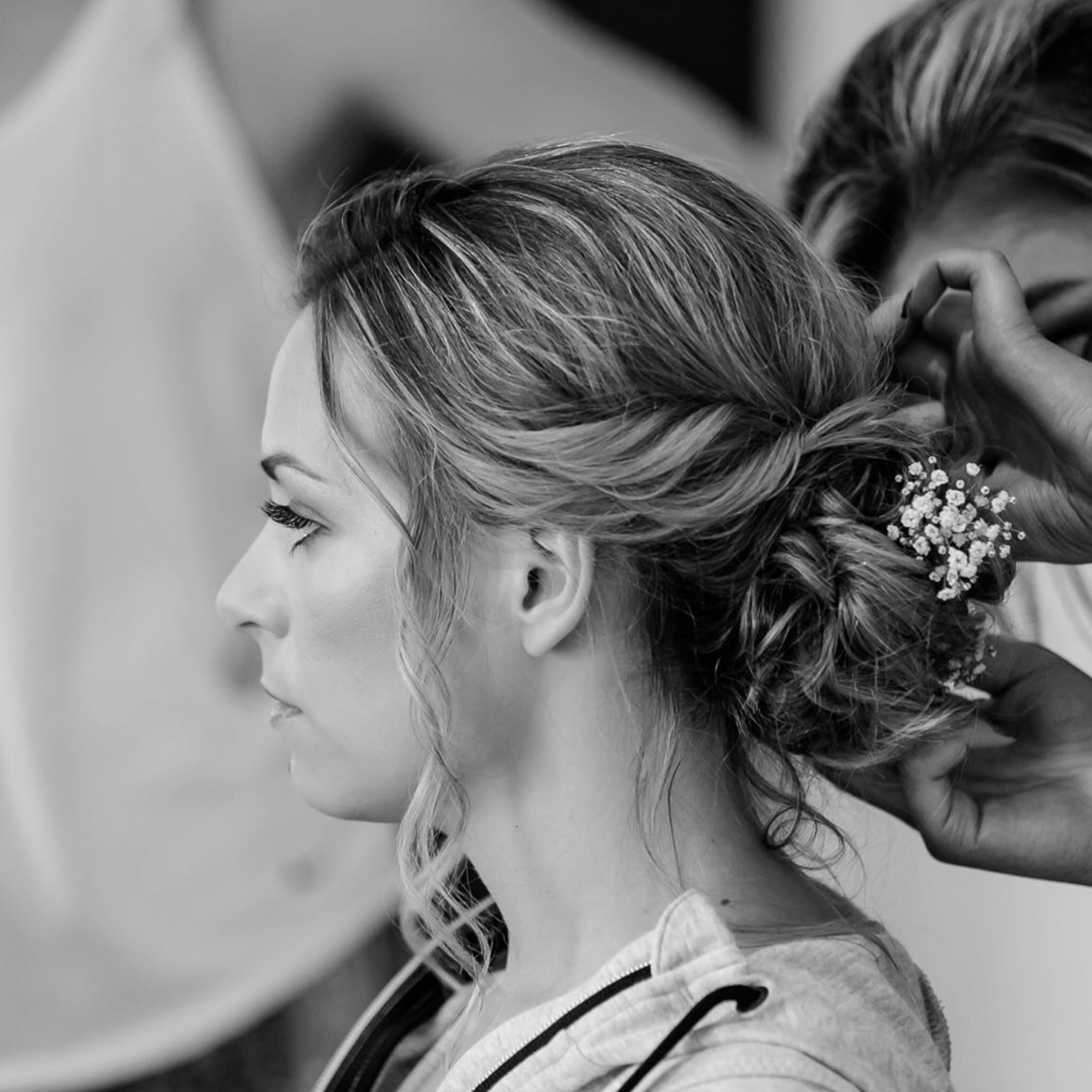 beautiful bride getting hair and makeup touch ups
