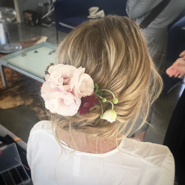 bohemian blonde brides hair up with rustic flower hairpiece