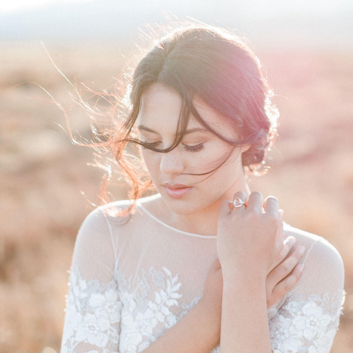 natural bronzed makeup and messy bun hair style on beautiful bride